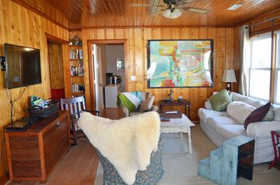 Comfortable Living room, flat screen tv, books and fan to keep you cool.