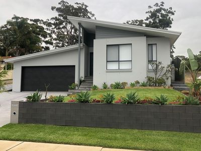 Photo for New -  Modern and Stylish Family Home Only 10 minute walk to Narrawallee Beach.