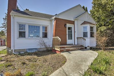 This 2-bed, 1-bath bungalow-style home sleeps 6 travelers.