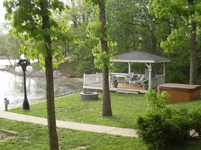 Enjoy the lakeside fire pit, hot tub, & gazebo