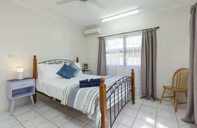 Comfy queen bed in light and airy main bedroom with air-con