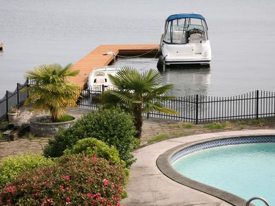 Photo for 2-Story Lake Front Home With A Swimming Pool, Sun Room, Boat Dock, And Balcony