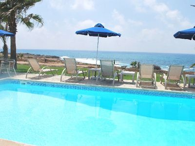 Photo for This wonderful villa enjoys a wonderful frontline, seafront location on the Paphos coast, just fifte