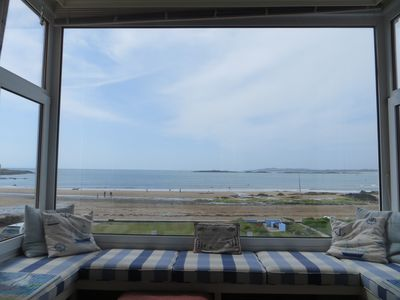 Photo for Stunning bay views and sunsets seen from all main rooms. Games room. Wetroom.