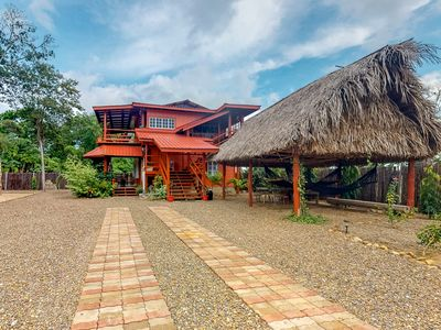 Photo for Wooden home w/ hammocks, BBQ area, enclosed yard - close to town and beach