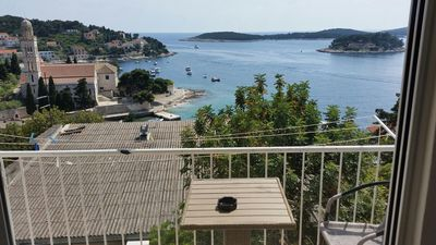 Photo for Two bedroom apartment with balcony and sea view Hvar (A-15856-a)