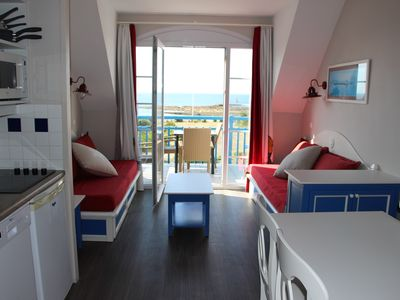 Photo for Beautiful sea view and everything on foot (beach, swimming pool, center, port ...)