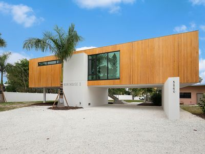Photo for Longboat Key canal front Villa with a private dock.Great Family retreat.