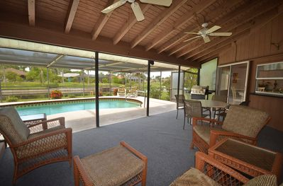 Expansive lanai with BBQ grill, furniture, and dining