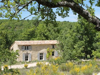 Photo for Typical Provencal stone house with pool in a quiet secluded location