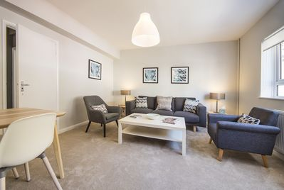 The first floor offers the main living space with comfortable sofa, TV and WIFI