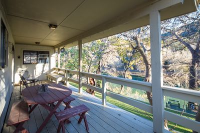 Beautiful Covered Deck Overlooking the Guadalupe River - Access this upstairs deck from the kitchen/dining area.