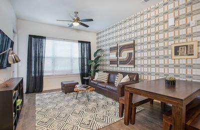 Photo for Modern apartment close to downtown with shared pool - dogs welcome!