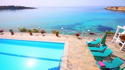 Photo for Beach Front Villa Offering Privacy And Modern Luxury Right On The Sandy Beach