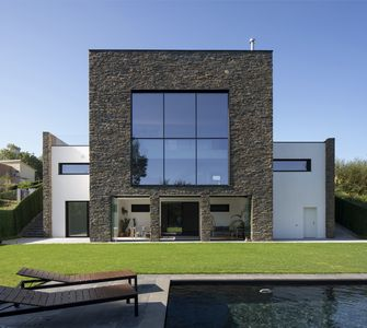 Photo for Modern house with pool and forest views.