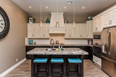 Kitchen View - This sleek, modern kitchen has all the best upgrades to make cooking a breeze!