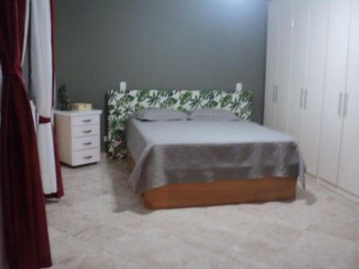 Photo for House 600m from the beach, 5 qtos, 4 parking spaces with pool and barbecue