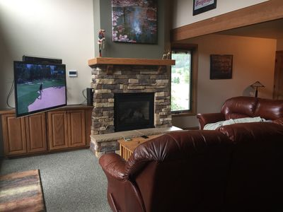 Big screen HDTV and gas fireplace.