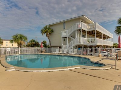 Photo for Convenient oceanview retreat with shared pool - close to the beach and shops