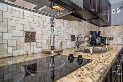 Large sink, coffe pot, toaster, cooktop-everything you need in our NEW kitchen