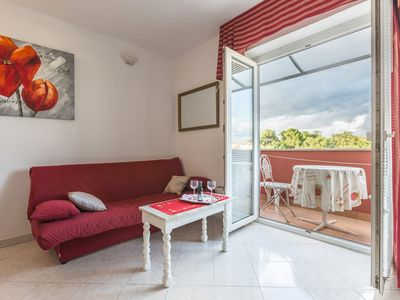 Photo for Top located apartment with beautiful garden and balcony with sea view