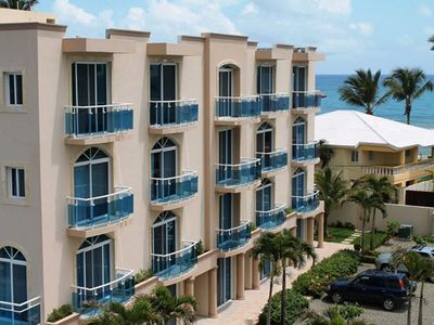 Photo for Oceanfront 3BD penthouse, sea views, pool, guest-friendly, top-floor
