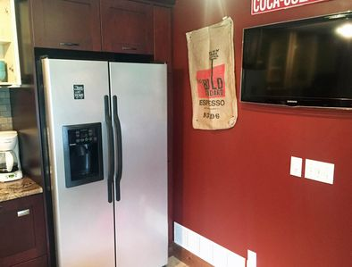 Full size refrigerator and 2nd TV in café/dining area