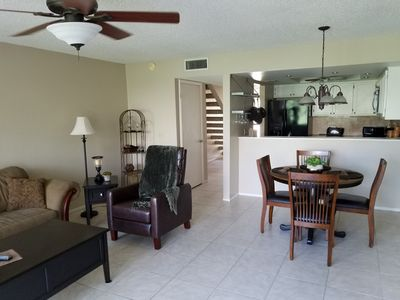 Photo for Relax in this country club townhome minutes from the beach