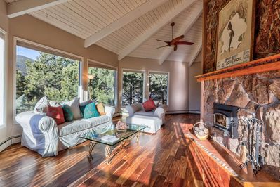 Relax and enjoy the panoramic mountain views and wood-burning fireplace in the second floor living room.