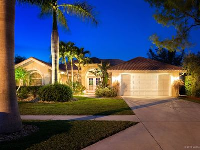 Lush palms and LED landscape lighting really makes a nice entrance to the home
