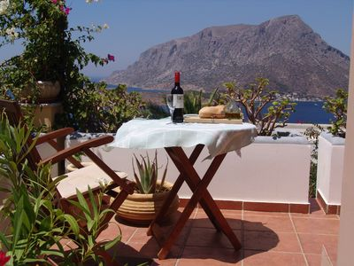 Simple lunch on the lower balcony looking west to Telendos Island and yachts.