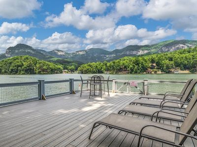 Photo for Lake front cottage with incredible mountain views and a pontoon boat!