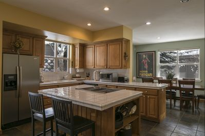 Kitchen with new stainless appliances, island and easy access to the dining room