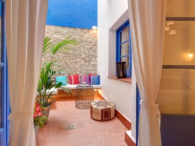 Photo for Charming apartment next to the beach in the old town