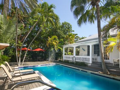 Photo for Classic Key West cottage featuring shared pool, courtyard, covered front porch