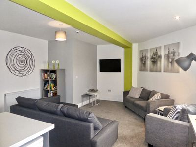 Open plan living area with Smart TV
