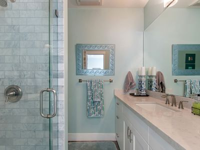subway marble tiles and wall to wall mirrors make this small bathroom feel large