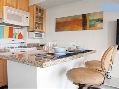 Photo for Delightfully furnished  one bedroom apartment with a spacious deck w/ city views