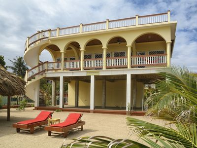 Photo for Beachfront Mellow Yellow Beach House Hopkins Belize. Discount-7-Night Booking