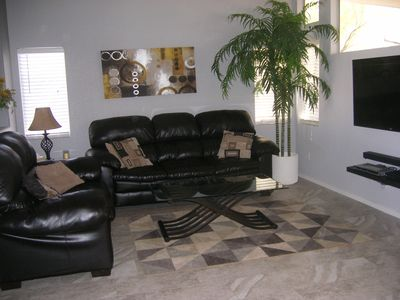 """Living area with 55"""" flat screen smart  tv"""
