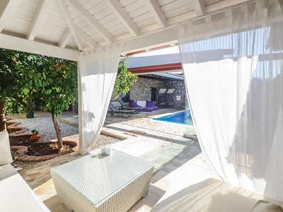 Photo for Tranquil villa w/ pool, Wi-Fi, air con + BBQ, walking distance to bars + beach