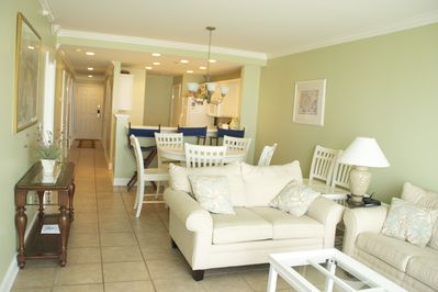 View of living and dining area.  Kitchen and entryway.