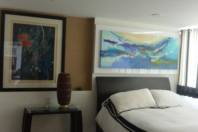one of 2 master bedrooms, new artwork
