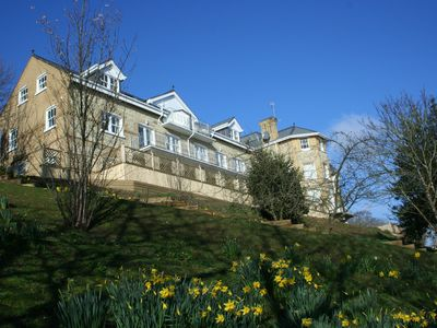 Photo for The Priory - luxury 2 bed cliff top apartment with large decking, garden + sea views