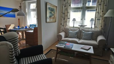 Lvrm with sofa, comfy chair and plenty of books and mags to brouse in.