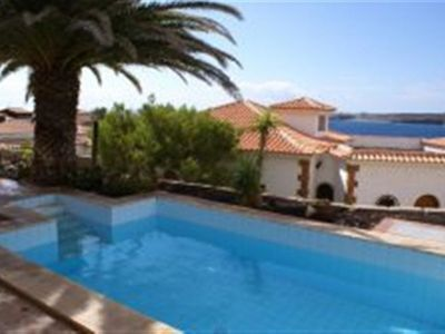 Photo for Beautiful apartment with private pool, WIFI, TV, washing machine, pets allowed and parking