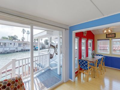 Photo for Waterfront home w/ shared pools, hot tub, private deck - jet ski slip - dogs OK