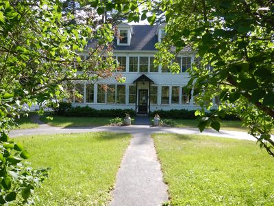 The front of the house as seen from between the lilacs.