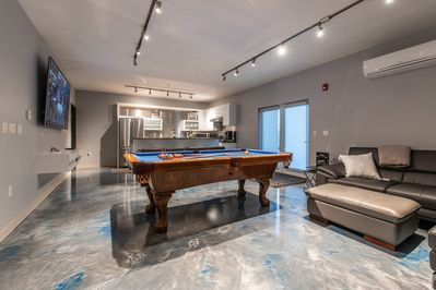 """Enjoy the entertainment-ready kitchen and lounge space. Pool table & 86"""" TV."""