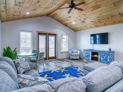 Photo for Redfish House: Gorgeous Pool, Outdoor TV and Fire Pit, Pets, Bay Views